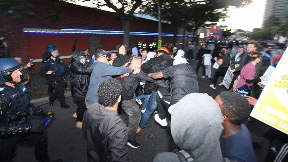 Protesters clash on a street outside the event in Melbourne