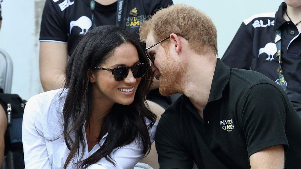 Prince Harry and Meghan Markle talking and smiling