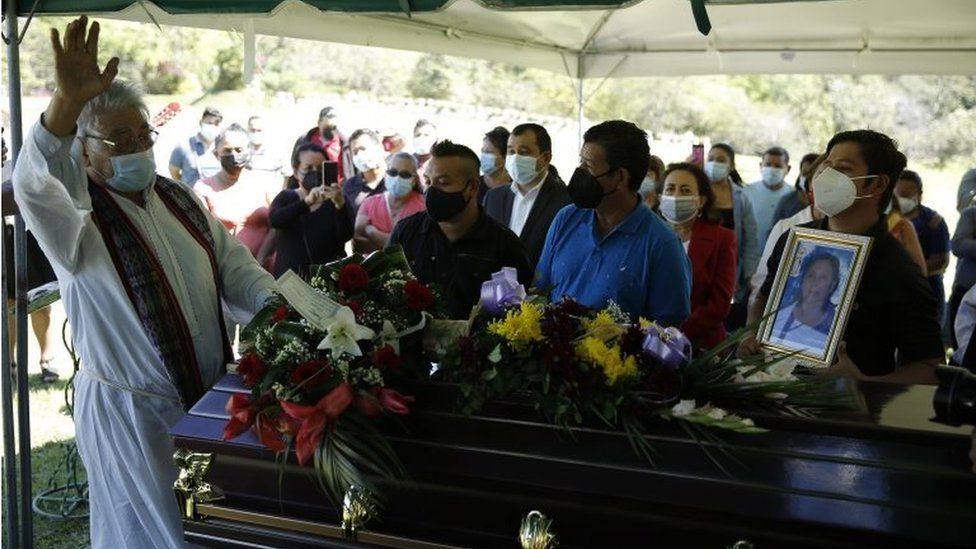 The priest Tilo Sanchez says a prayer during the funeral of Gloria Maria Rogel, a supporter of the FMLN party who died after an armed attack on 31 January, in Soyapango, El Salvador, 02 February 2021.