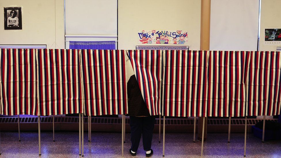 A lone voter casts her vote at a polling station inside a school, during the Super Tuesday Republican primary elections in Cambridge, Massaschusetts,