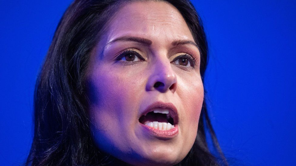 Priti Patel speaking at the policing summit