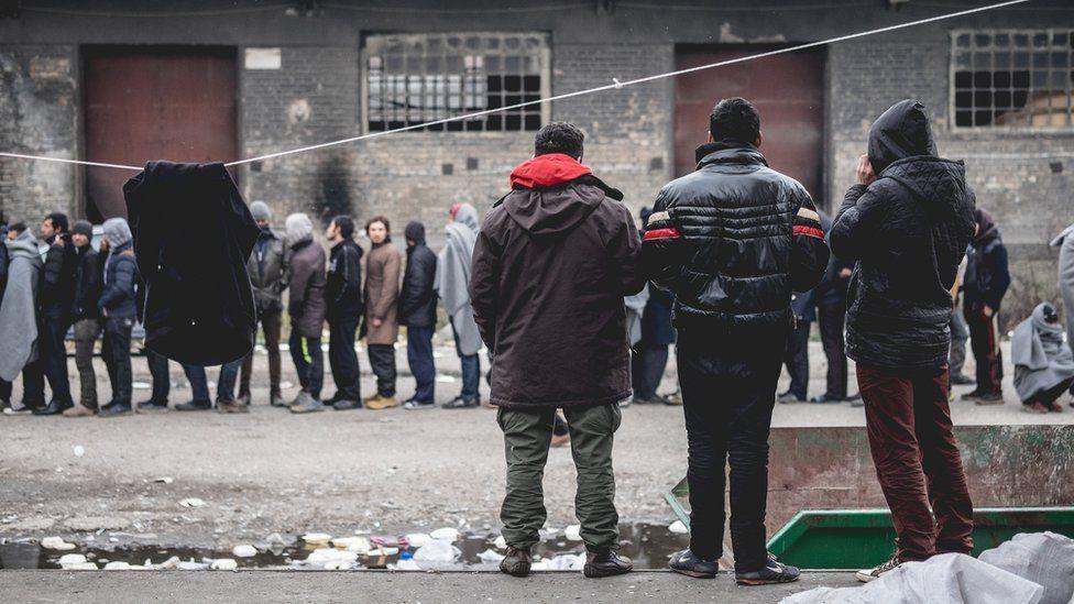 Refugees queue in Belgrade