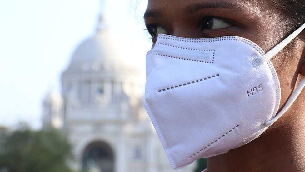Woman with mask on in Kolkata, India