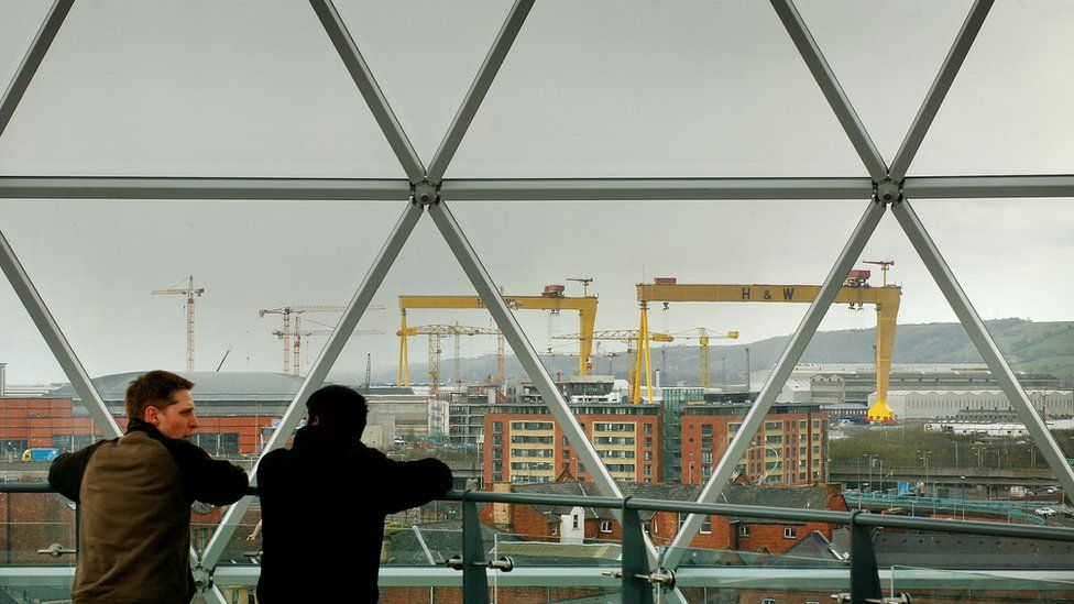 Locals look at Belfast from the observation dome above the Victoria Square shopping development