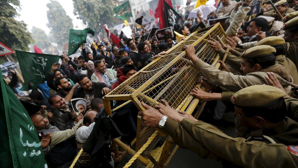 Shia Muslims push barricades installed by police during a protest against the execution of cleric Nimr al-Nimr in front of Saudi Arabia embassy in New Delhi, India, on Monday 4 January 2016