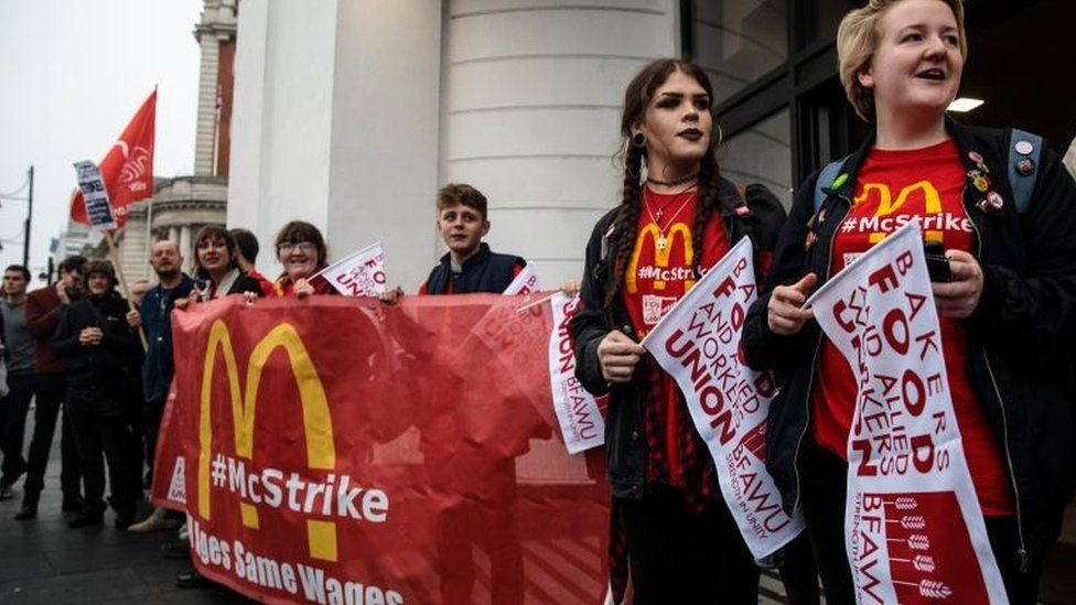 Protesters demonstrate outside a McDonald's restaurant in Brixton in support of striking fast food workers
