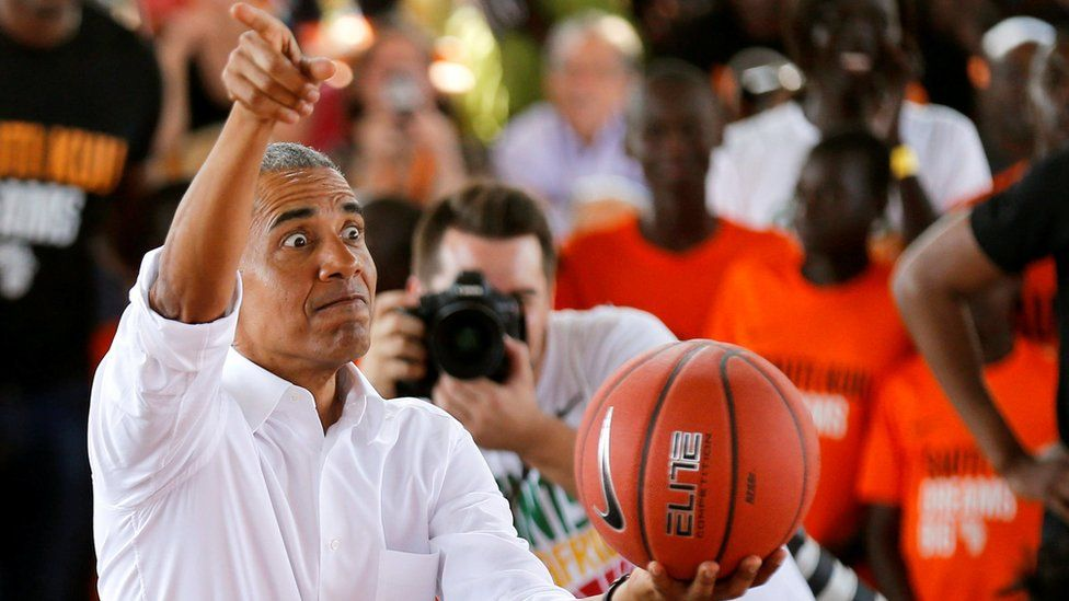 Barack Obama holds a basketball as he addresses people at the launch of Sauti Kuu resource centre in Kenya - Monday 16 July 2018