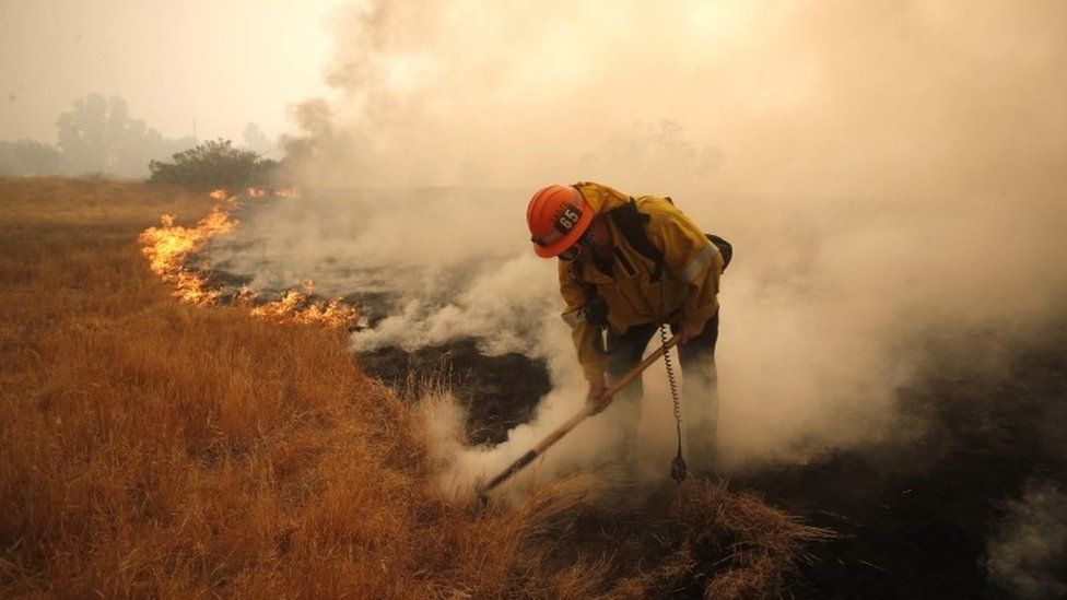 Firefighter tackles a fire in California
