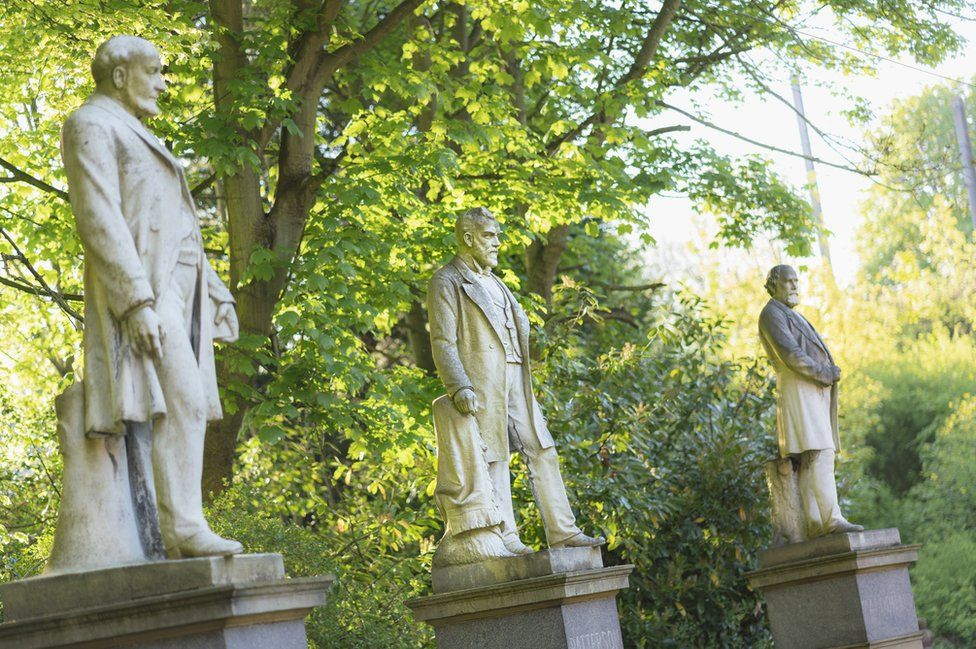 Statues of the Durham Miners' Association founders in the grounds of the property