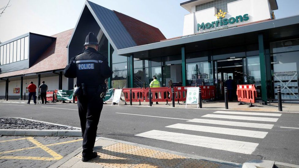 A police officer in Hampshire outside Morrisons