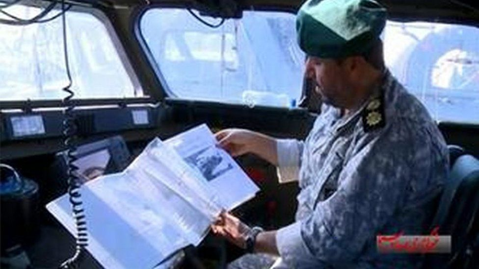 Iranian officer apparently pictured during detention of US sailors on Tuesday, in pictures carried by Iranian state broadcaster Irib News