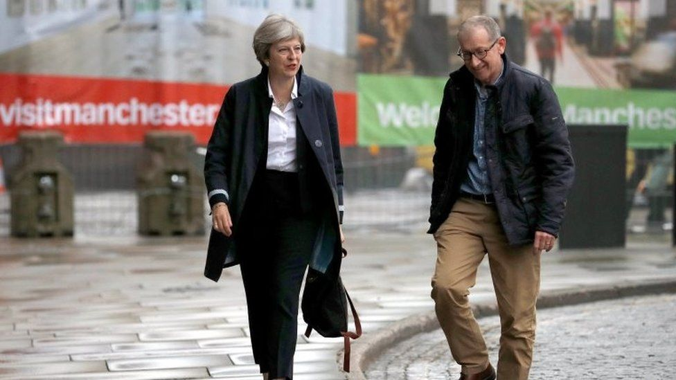 Theresa May and her husband Philip arriving in Manchester