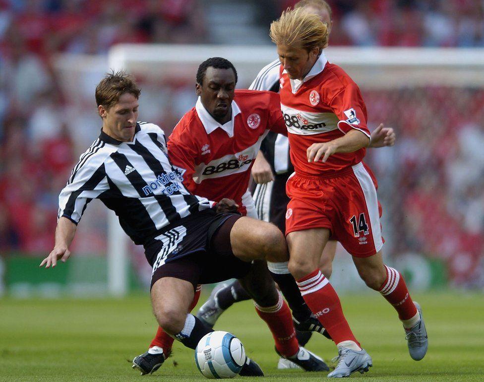 Gaizka Mendieta of Middlesbrough clashes with Robert Elliott of Newcastle