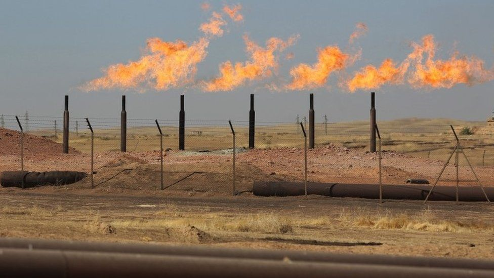 Excess flammable gasses burning from gas flares at the Bai Hassan oilfield, west of the multi-ethnic northern Iraqi city of Kirkuk (17 October 2017)