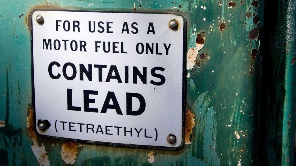 """Old petrol pump sign saying """"For use as a motor fuel only. Contains Lead (Tetraethyl)"""