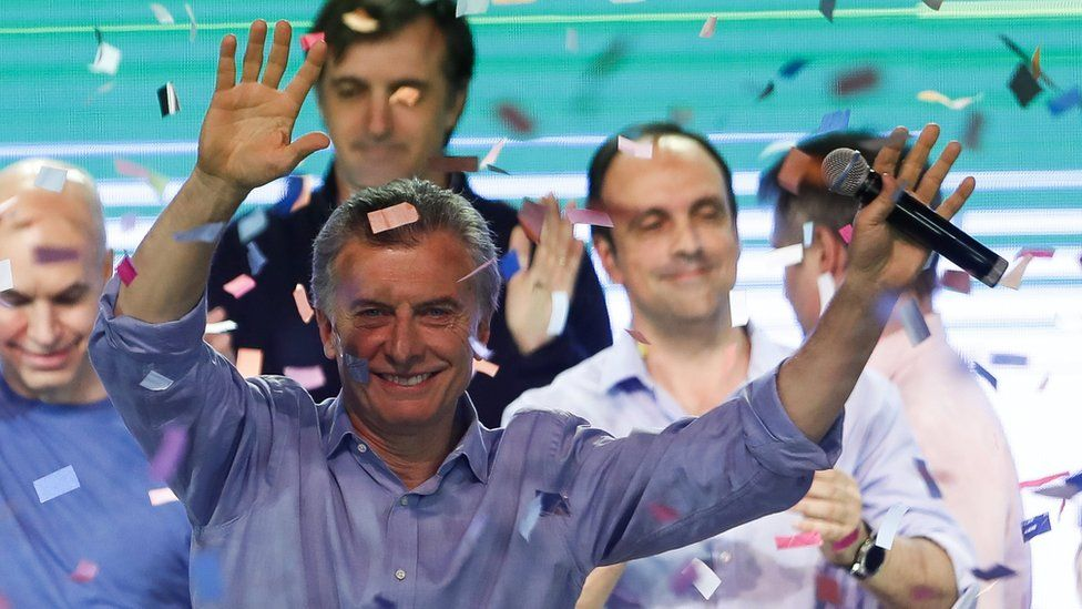Argentine President Mauricio Macri greets supporters at the Cambiemos headquarters, in Buenos Aires