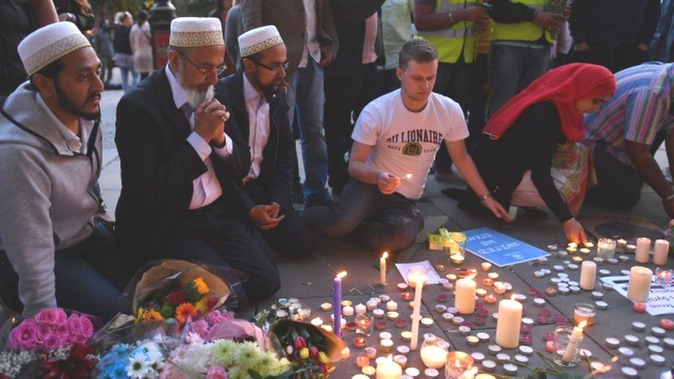 Mourners at the makeshift memorial in Manchester's Albert Square, following the attack there