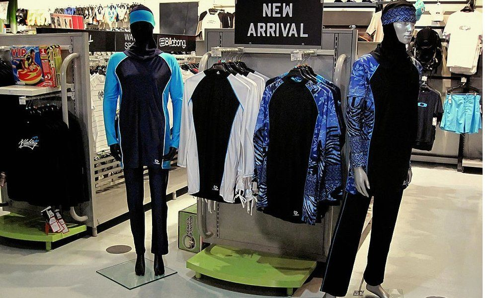 The Islamic full-length swimming suit known as burkini is displayed on mannequins at a sports store in Dubai on August 23, 2009