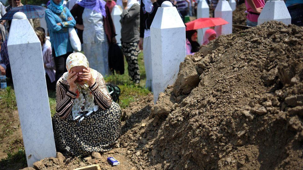 A Bosnian Muslim woman cries on July 11, 2010 during a mass burial for 775 newly identified victims of the 1995 Srebrenica massacre at the Srebrenica Memorial Cemetery in Potocari