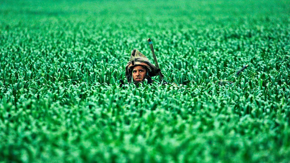 An Israeli soldier walking in fields near the Gaza Strip in 2008
