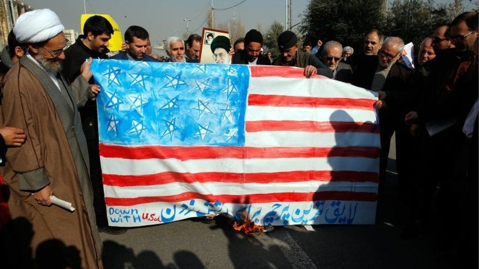 Iranians burn a US flag during a pro-government demonstration after the Friday prayer ceremony at the Imam Khomeini mosque in Tehran, Iran, 5 January 2018.
