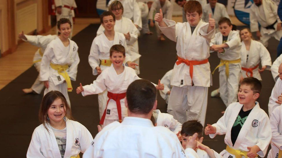 Children taking part in a judo class with the iCan judo group