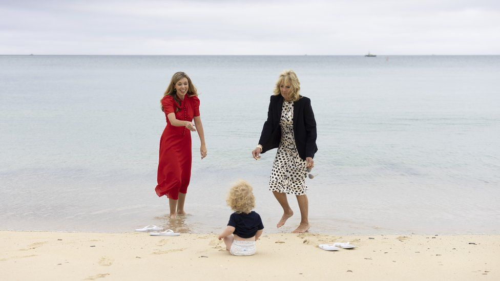 Carrie Johnson plays with her son Wilfred on the beach with Jill Biden
