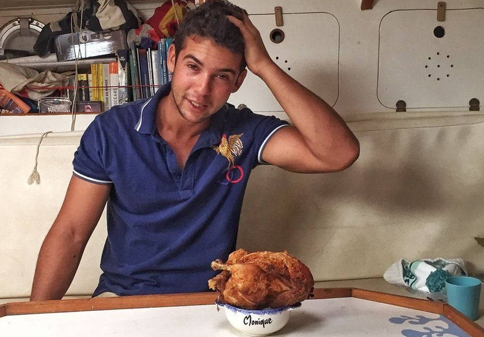 Sailor Guirec Soudee with a roast chicken in a bowl saying 'Monique'