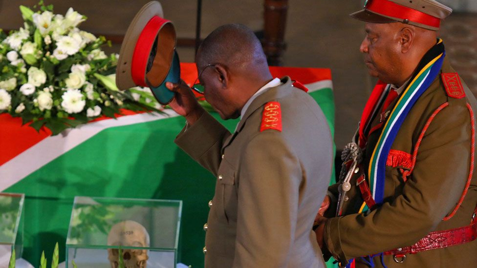 Members of a Namibian delegation attend a ceremony in Berlin, Germany, for the returning of human remains