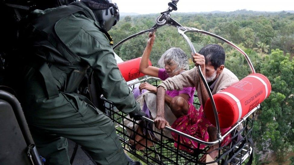 People are airlifted by the Indian Navy soldiers during a rescue operation at a flooded area in the southern state of Kerala, India, 17 August 2018