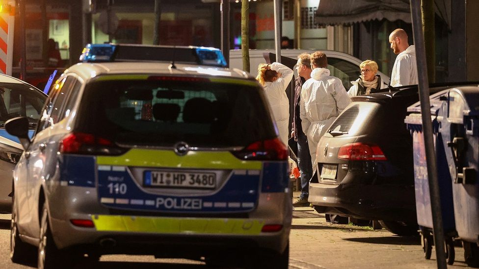 Forensic officers at the scene of one of the Hanau shootings