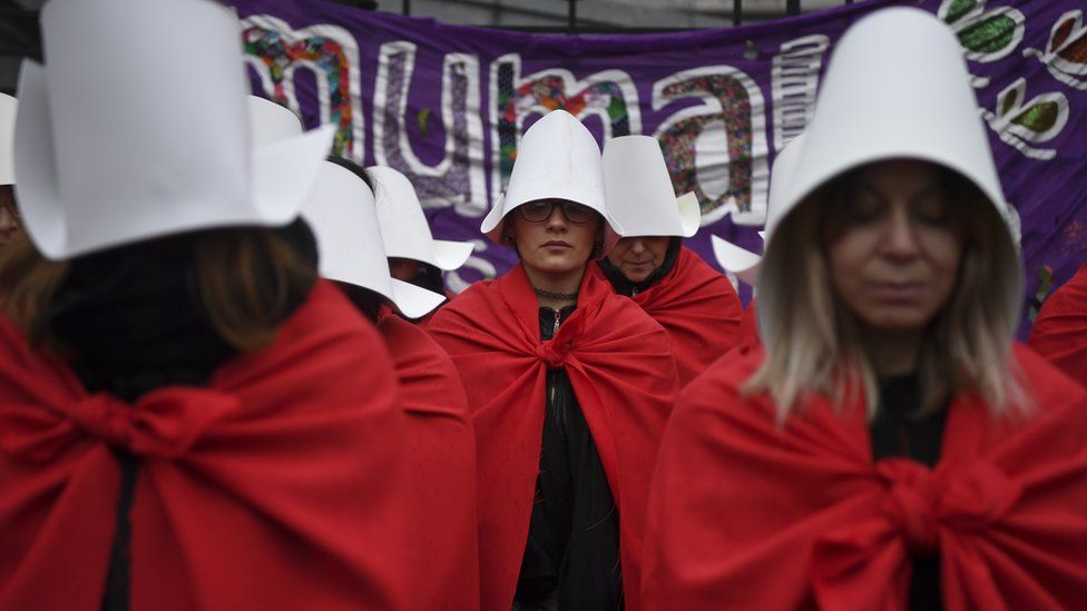 protesters in Argentina dressed as handmaids