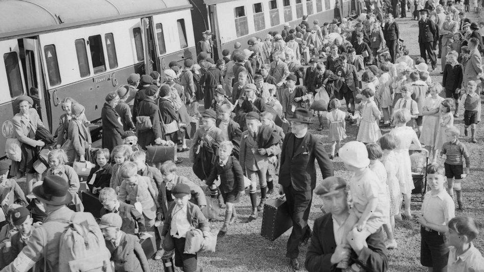 Evacuees near a train