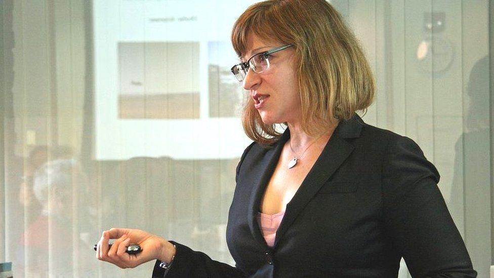Jacqueline Hazelton giving a lecture at Harvard