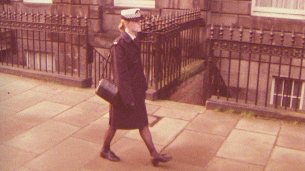 The policewoman's uniform included a handbag