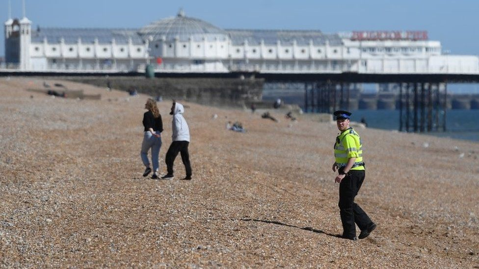 A police officer patrols Brighton beach on April 04, 2020 in Brighton, England.