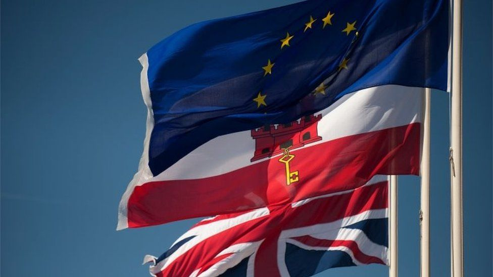 Union Jack flag, the flag of Gibraltar and the EU flag