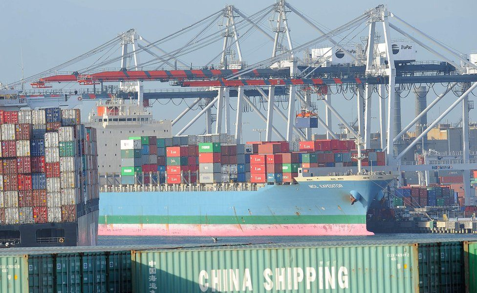 Containers are offloaded from a ship at the Port of Los Angeles in San Pedro, California