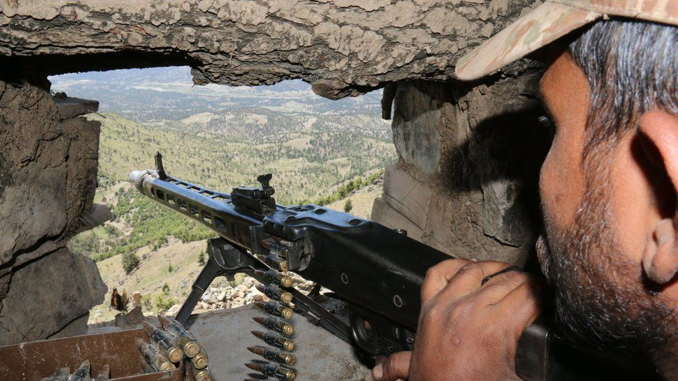 A Pakistani soldier keeps vigil from a post on top of a mountain in the former Taliban militants stronghold border area in Shawal valley on 20 May 2016