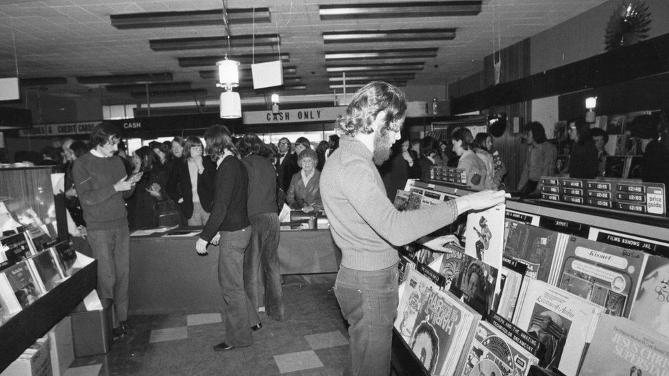 Shoppers browsing and buying in HMV in 1976