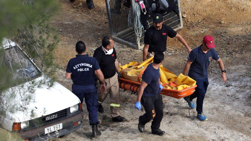 Members of Cyprus Special Disaster Response Unit carry a body retrieved near the so-called Red Lake, Cyprus, 5 May 2019