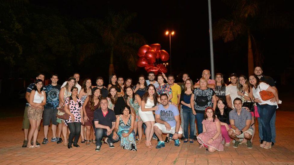 Flavia, Diogo and friends and family at the scene of the proposal