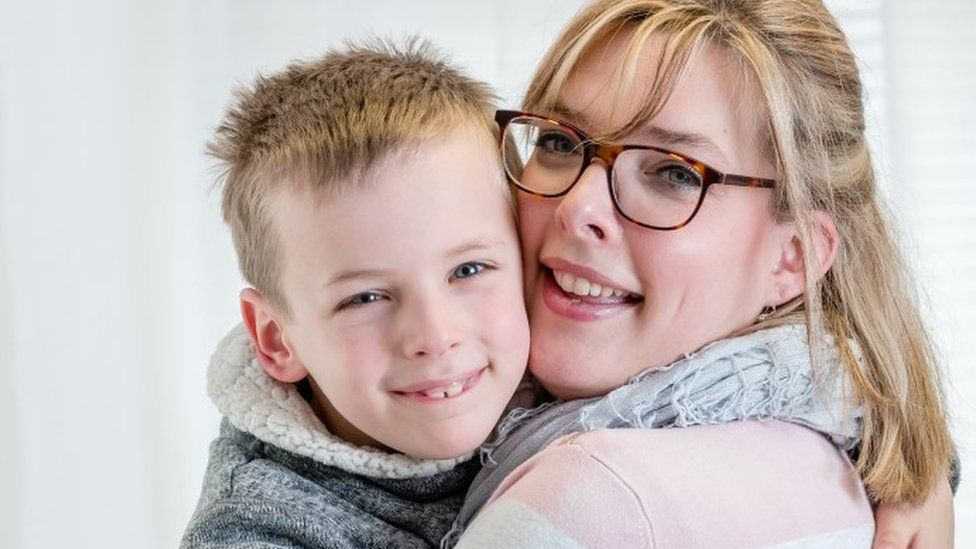 Nathalie Newman and son Callum, seven. Callum has 28 allergies, eight of which are life-threatening