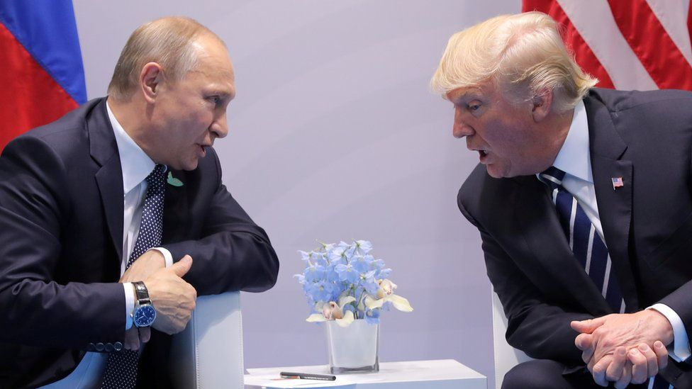 Russian President Vladimir Putin speaks with Donald Trump during their bilateral meeting at the G20 summit in Hamburg, July 7, 2017