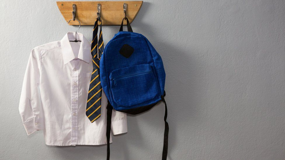 School uniform hanging on pegs
