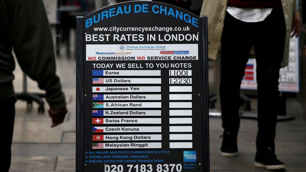 "A bureau de change advertises its"" rates on board in London, Britain October 7, 2016"