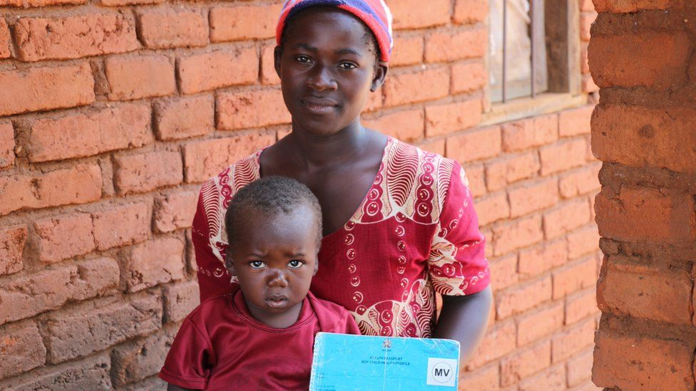 Evison and his mother after receiving his vaccine in Malawi. He was the second child vaccinated in Malawi for the malaria vaccine implementation program.