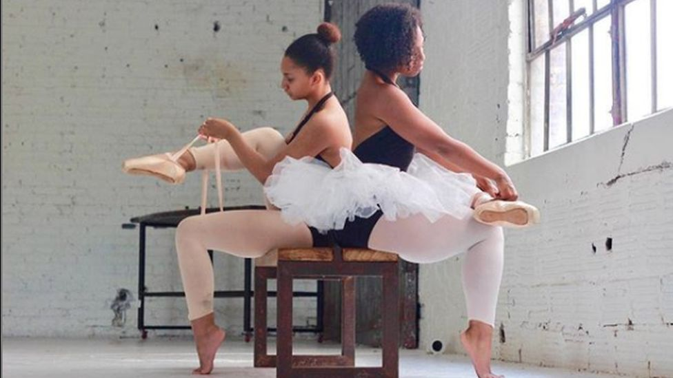 Photo of two ballet dancers