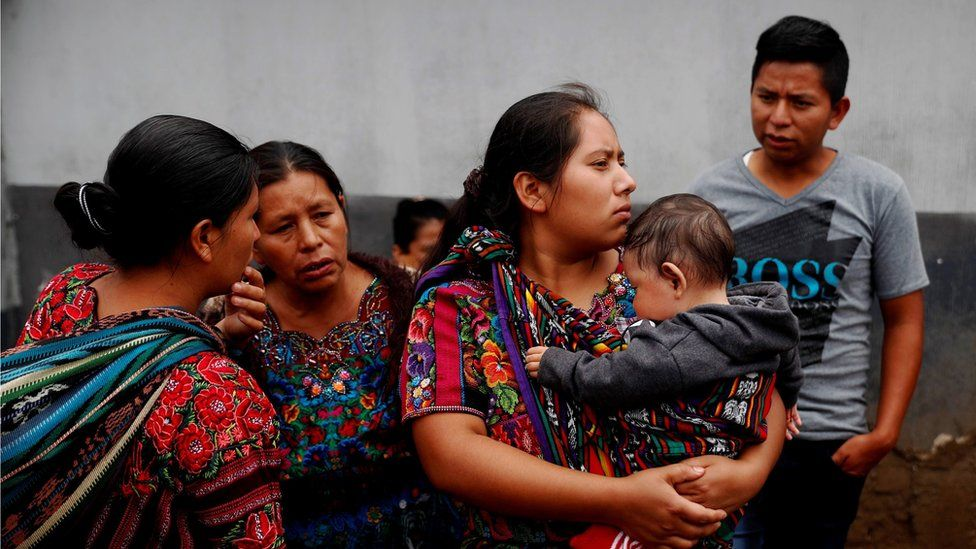A group of people wait for their relative who arrives deported from the United States together with a group of migrants, in Guatemala City, Guatemala,