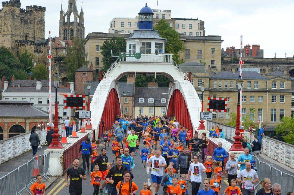 Runners cross the Swing Bridge